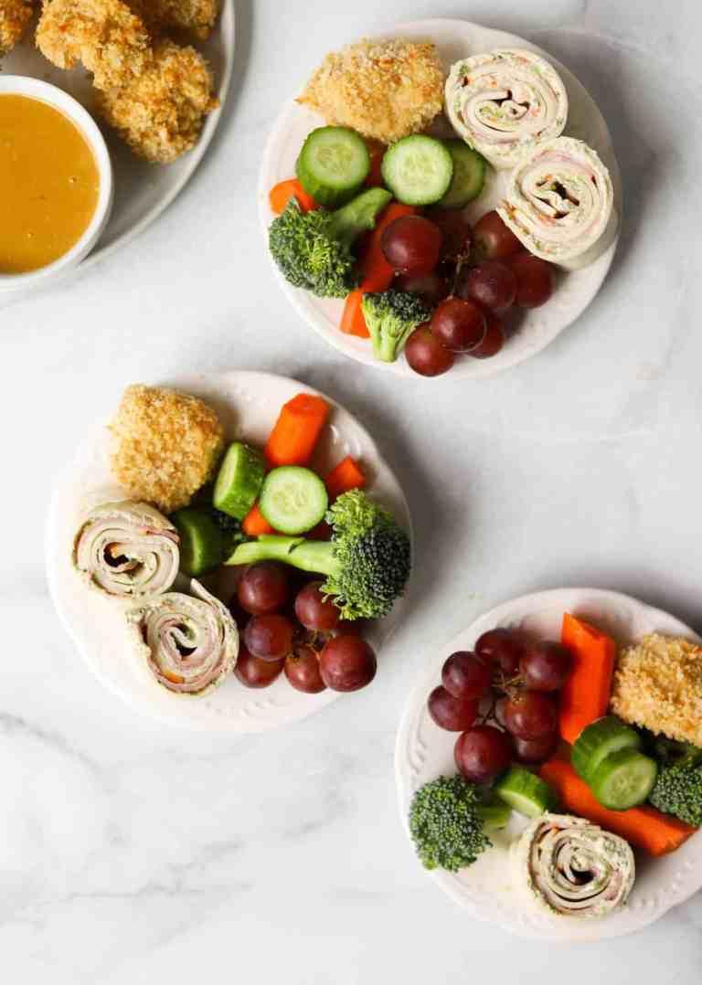 Mini snack plates on white marble backdrop