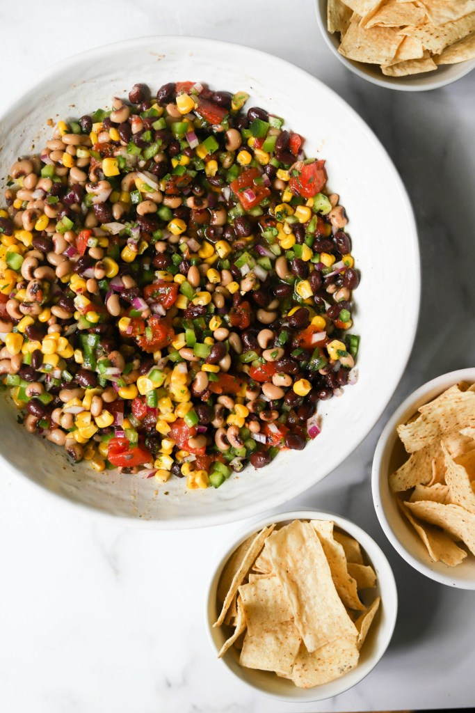 Cowboy caviar in a white bowl with tortilla chips