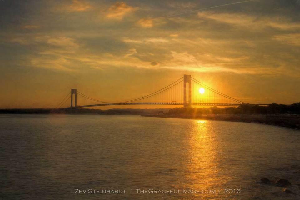 The sun setting behind the Verrazano-Narrows Bridge in Brooklyn on a July evening.