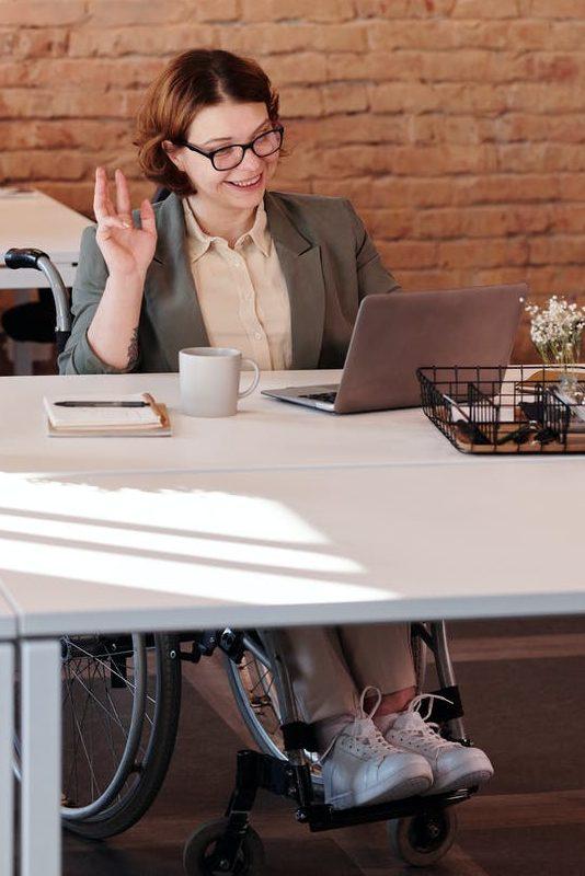 woman smiling while using laptop