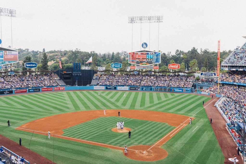 men playing baseball in stadium