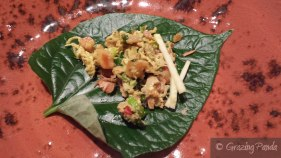 Close up of Kun Sar Thi - Betel leaf w chicken, shallot, green mango & Sichuan pepper