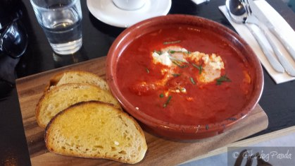 Shakshuka - 2 Eggs Baked in Tomato Sugo, Capsicum, Basil & Feta served with Grilled Sourdough_