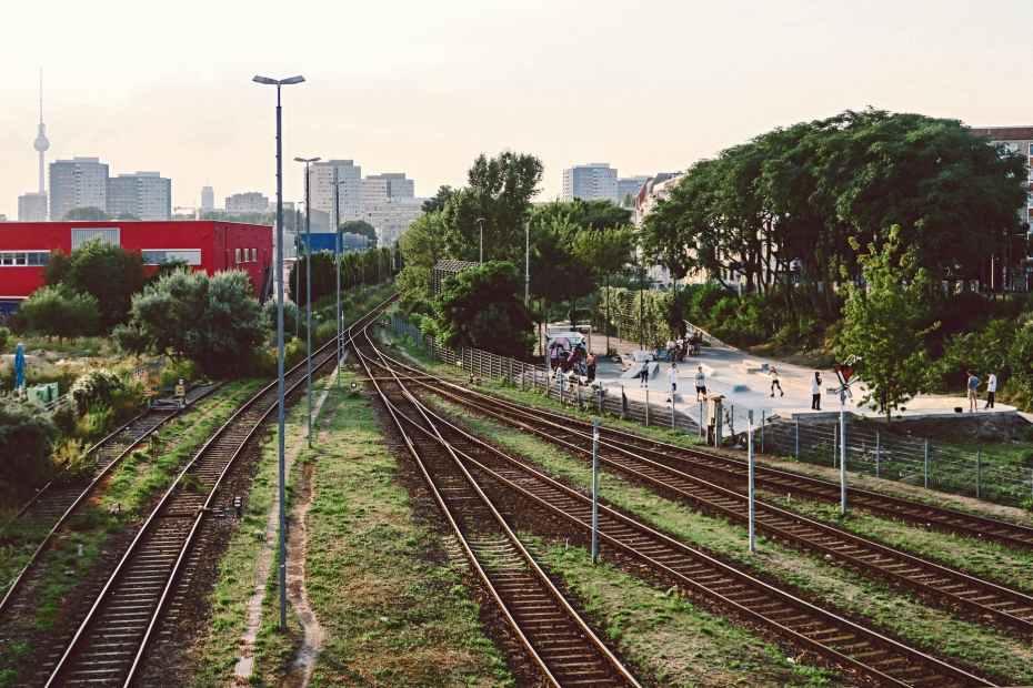 railways beside red building