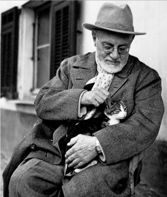 Henri Matisse (1869-1954) enjoying an afternoon break from painting with his cat, Minouche, at his apartment and studio in Nice. cat art, cats in art