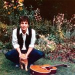Syd Barrett (founder of Pink Floyd) with his cat and guitar about 1966