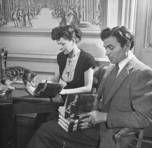 James Mason and wife signing books with cat