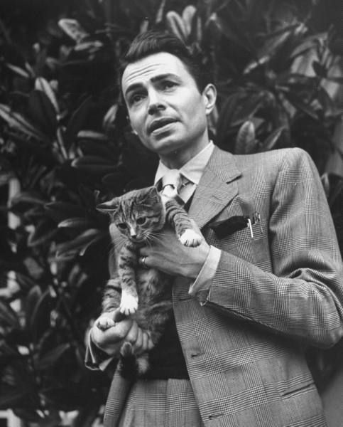 James Mason holding cat