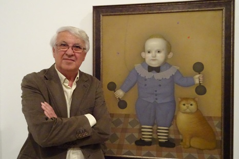 Juan Béjar with his painting