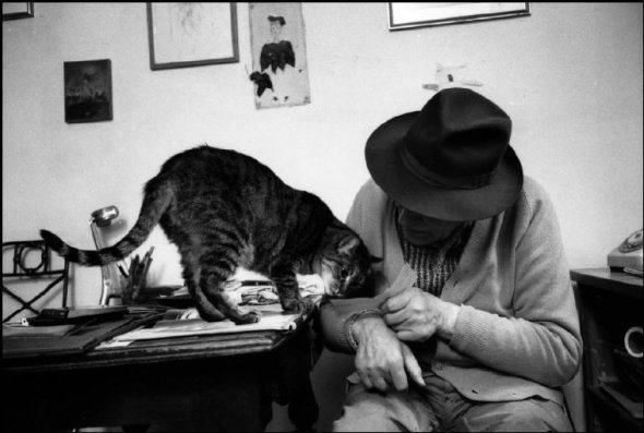 Swiss sculptor Diego Giacometti at home with Cat, Martine Franck