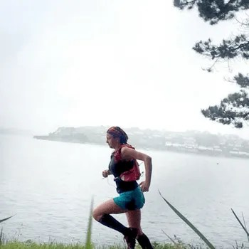 Woman running near water