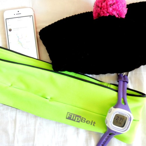 The flipbelt with a running watch, hat and phone