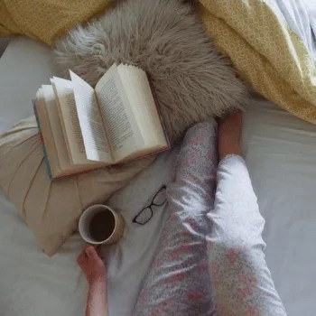 Legs with a book and coffee