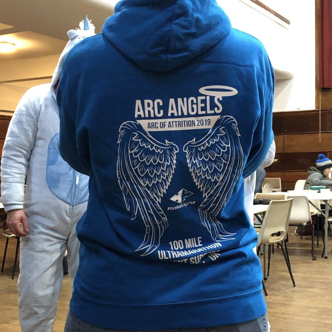 Lady's back in blue hooded top