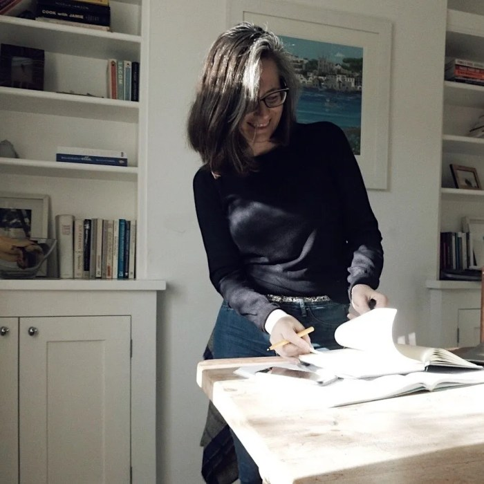 Lady standing by table with notebook