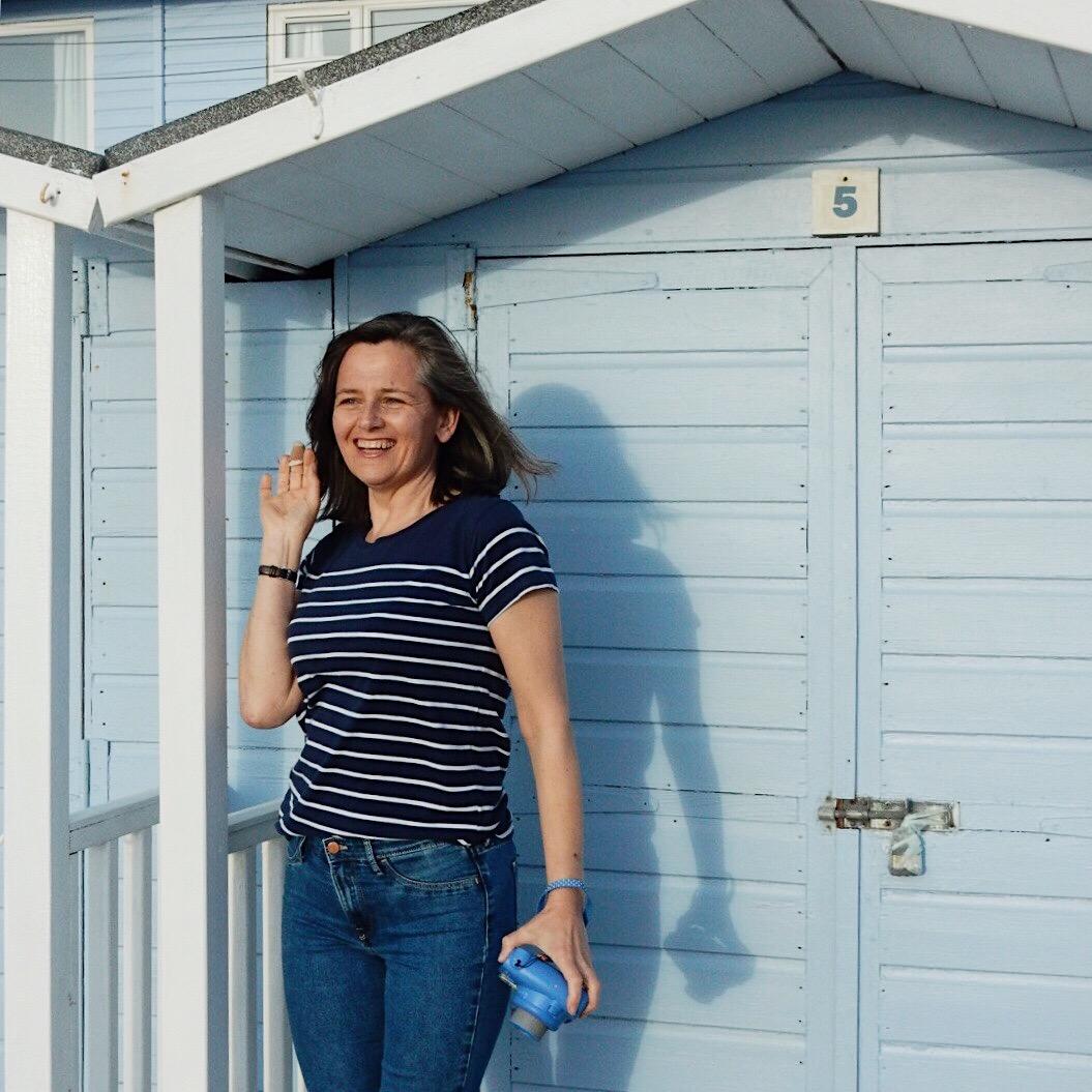 Penny Bedford outside a beach hut