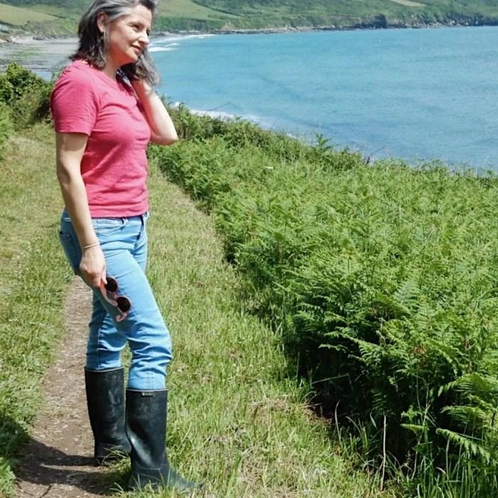 Lady Standing on Coastpath