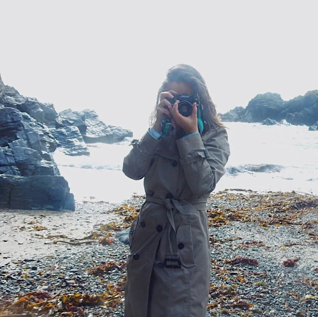 Woman holding Camera Cadgwith