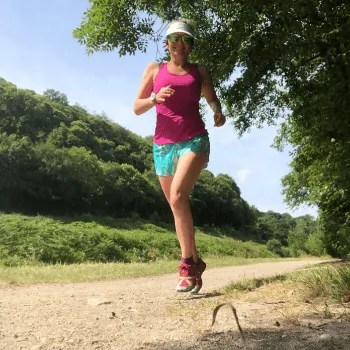 Woman running on a flat trail