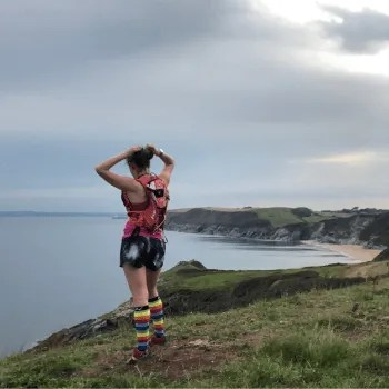 Women in running kit looking out to sea.