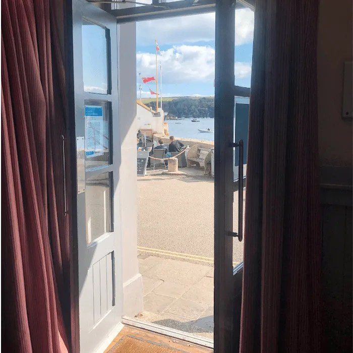 Looking out from the St Mawes Hotel to the Harbour Office