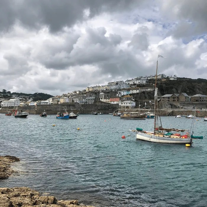 Mevagissey harbour with a fishing boat in the foreground
