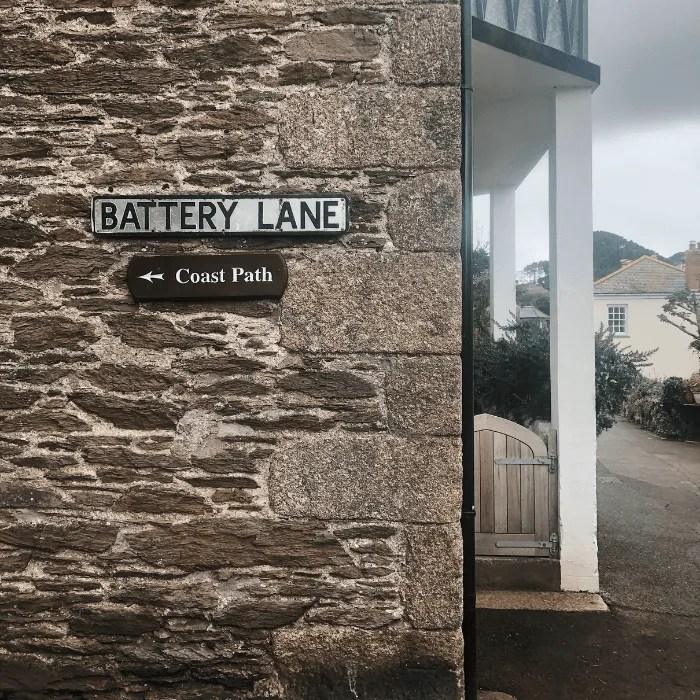 The brick work on the side of a house and road sign for Battery Lane