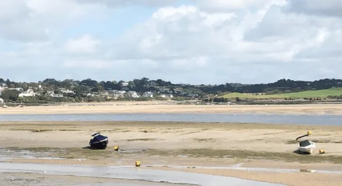 a boat on the sand on the Camel estuary