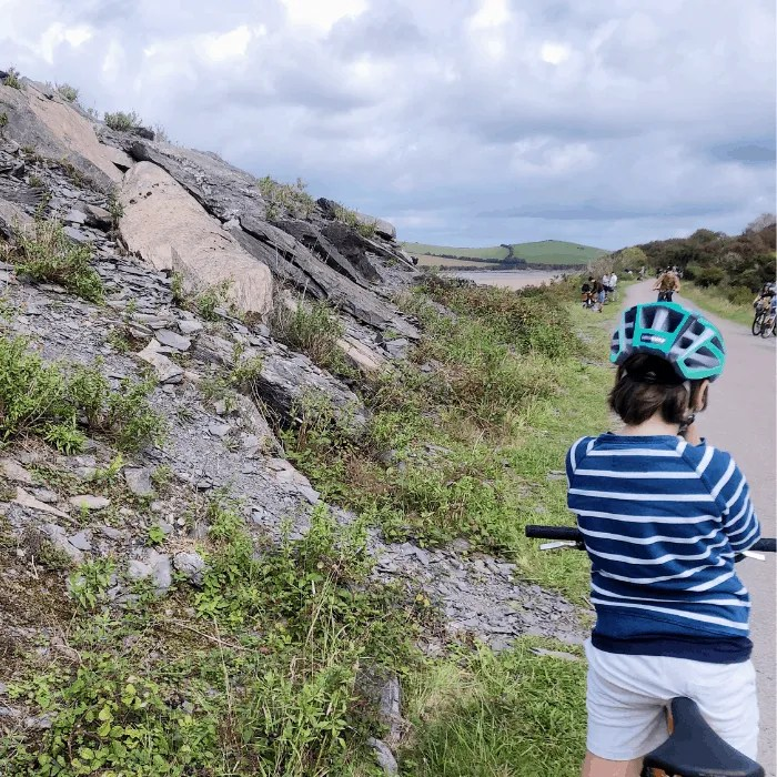 A boy on a bike on the Camel Trail Cornwall