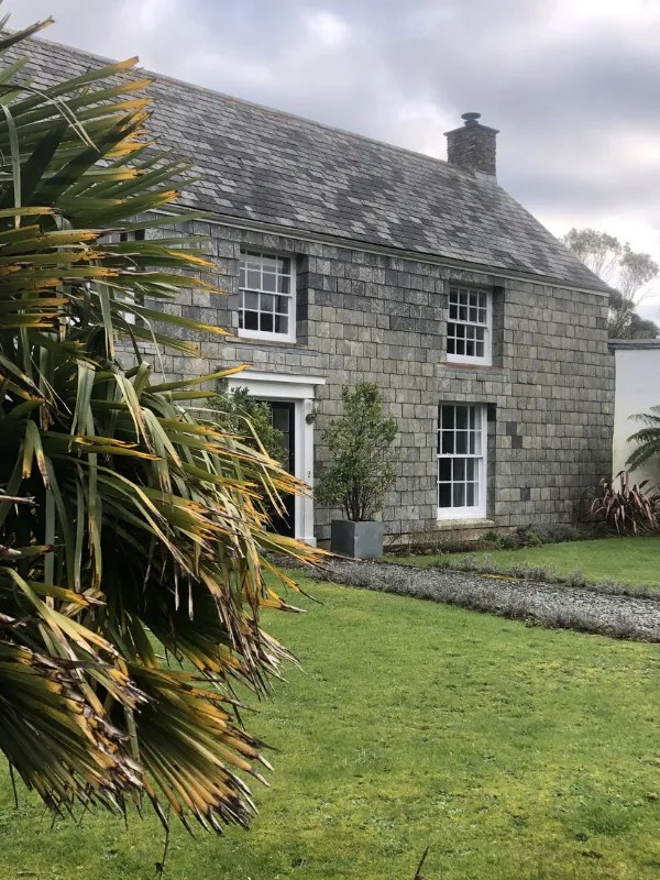 A slate fronted detached house and garden