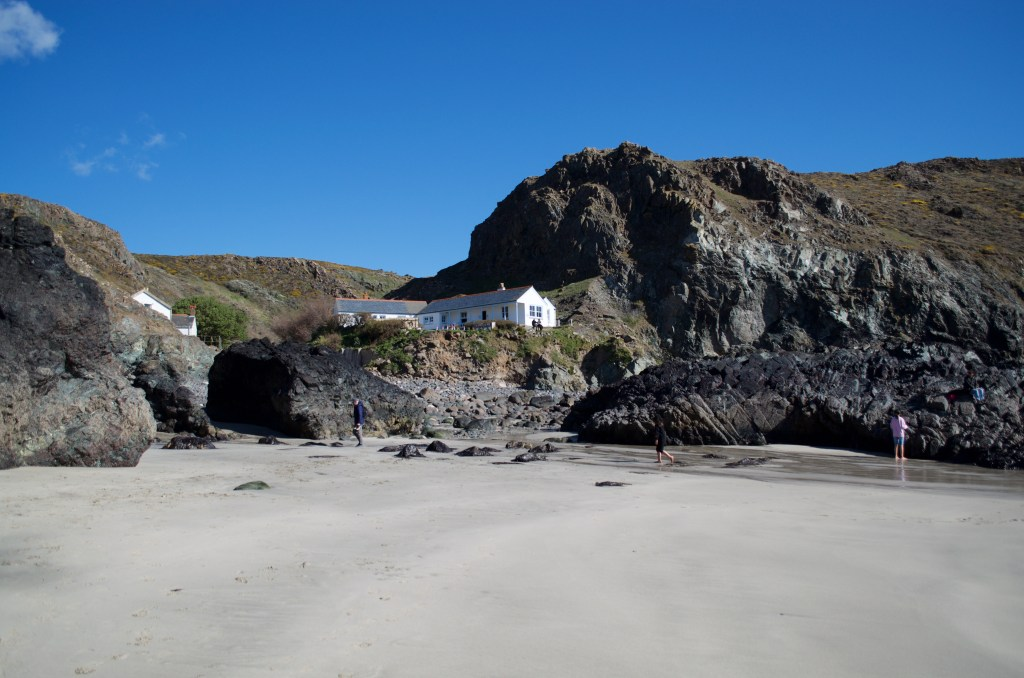 The beach and a white building in the cliffs