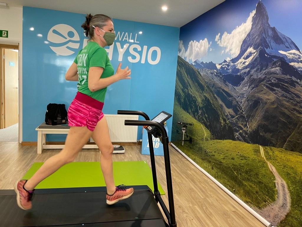 Woman running on a treadmill at The Run Lab