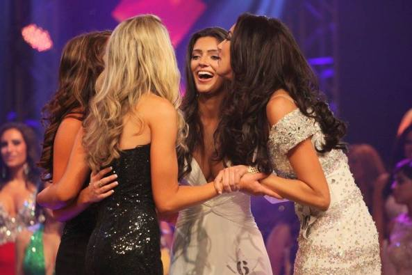 The top four finalists for the Miss Florida USA 2015 pageant held hands before the announcement of the winner