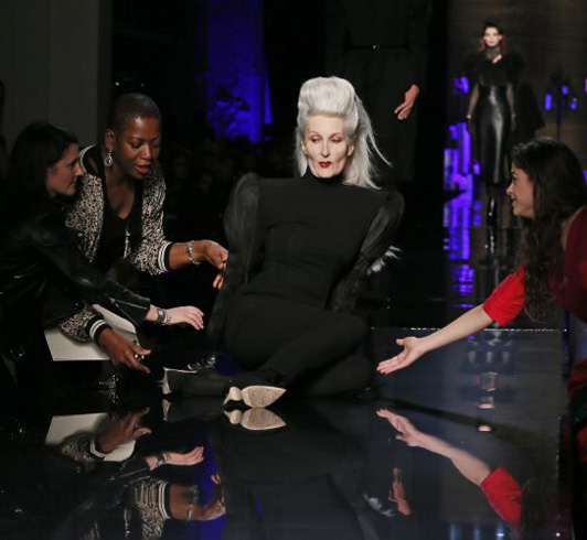 56 year old Swiss model Catherine Loewe tripped while walking for Jean Paul Gaultier.