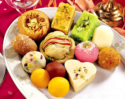Sweets are a symbol of joy. They are a symbol of happiness. People ask you to have sweets out of joy. Because sweets are SWEET! And we have to give that to them. It's family love. You can't really enjoy a festival if there are no sweets. It's like a pageant without Q/A round. ;)