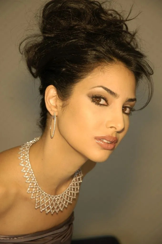 "Ramona Amiri, Iranian Canadian woman of Assyrian and Persian heritage, who was Miss World Canada (2005). she quotes Persian poet Rumi ""Work like you don't need money, love like you've never been hurt, and dance like no one is watching"" (PC-persiantopmodels.com)"