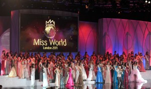 Miss World contestants pose on stage during the finals of Miss World 2011 at Earl's Court in London, on November 6, 2011. The glitz and glamour of Miss World returns to its British home to celebrate the global beauty contest's 60th birthday. A record 122 beauty queens from Albania to Zimbabwe take part in the pageant, which will be broadcast live to more than 150 countries.  AFP PHOTO/BEN STANSALL (Photo credit should read BEN STANSALL/AFP/Getty Images)