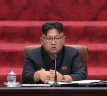 Kim Jong-un sits alone
