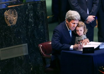 "NEW YORK, NY - APRIL 22:  U.S. Secretary of State John Kerry holds his two year-old grand daughter Isabel Dobbs-Higginson for the signing of the accord at the United Nations Signing Ceremony for the Paris Agreement  climate change accord that came out of negotiations at the COP21 climate summit last December in Paris. on April 22, 2016 in New York City. At least 155 countries are expected to sign the agreement which has the goal of limiting warming to ""well below"" 2 degrees Celsius above preindustrial levels. The ceremony symbolically takes place on Earth Day.  (Photo by Spencer Platt/Getty Images)"
