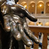 Hand of a sculpture in a group of people which I did not get the name of, grrr