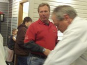 BBQ Bob cuts meat while Rob Russell scans the class.
