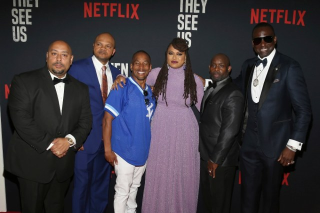 "In this May 20, 2019 file photo, Director Ava DuVernay, center, with the Central Park 5: Raymond Santana, from left, Kevin Richardson, Korey Wise, Anthony McCray and Yuesf Salaam, attend the world premiere of ""When They See Us,"" at the Apollo Theater in New York. A former prosecutor in the Central Park Five case has resigned from at least two nonprofit boards as backlash intensified following the release of the Netflix series ""When They See Us,"" a miniseries that dramatizes the events surrounding the trial. (Photo by Donald Traill/Invision/AP)"