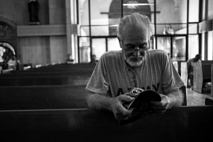 "Deported U.S. Army and Vietnam War veteran Jose Bustillos, 73, prays inside the Catedral de Nuestra Senora de Guadalupe in Ciudad Juárez, Chihuahua, México, Friday, July 27, 2018.   Bustillos served in the Army between 1964 and 1967 including two deployments to Vietnam where he was sent as a mortar sergeant to provide security on base and mechanical support for vehicles that were shipped out. He received an honorable discharge.   Bustillos went on to work at the railroad and then as a truck driver, a job he kept for 20 years.   In 1997, he was arrested for driving a U-Haul loaded with marijuana and was charged with transporting narcotics. Bustillos was sentenced to two years in jail and was deported in 1999 upon completion of his criminal sentence. He decided to illegally reenter the United States in the mid-2000s and was caught by ICE in 2012. He spent a year in detention and was deported a second time in 2013.   ""I messed up doing what I did, I should have known better,"" said Bustillos. ""Hey, so I'm paying the price. Hopefully some day, not for me, for the younger guys, I hope they can get back and get back into the states. Me I'm 73, I don't really care that much, but I would like to go back and visit.""   His daughter, who was about six when he left, is now 26. (Photo by Joel Angel Juárez/GroundTruth)"
