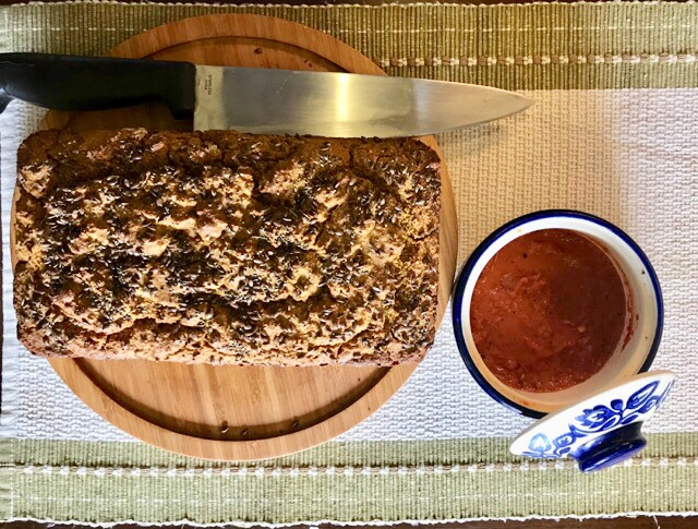 Quinoa and oats bread with roasted bell pepper sauce