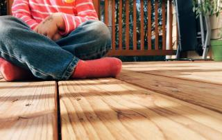 Girl sitting crossed on the porch - It can be hard to talk to your child about scary stuff. Terrorism and tragedy are not easy for anyone. Here are several ways to talk to your kids about it.