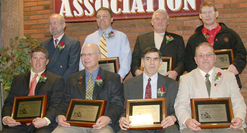 2006 MWCA Dave Bartelma Hall of Fame Inductees. Front (L-R): Mark Krier, Dennis Kaatz, Al DeLeon, and Ron Ackerman. Back (L-R): Pat Marcy, Pat Dorn, Larry Lyden, and Clay Nagel.