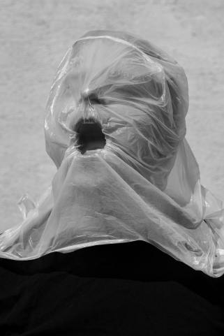 face covered with plastic bag