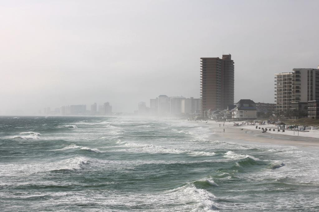 windy, rainy day at the beach with buildings in the fog