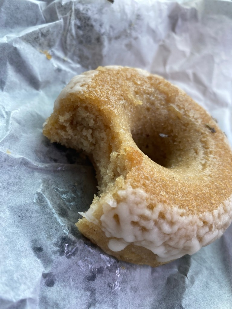 a bite out of a vanilla and lavender donut