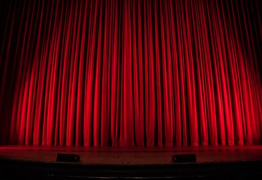 A closed stage curtain